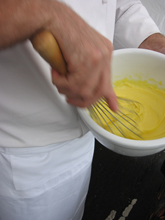 whisking yellow substance for cooking demo