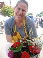 volunteer with flowers