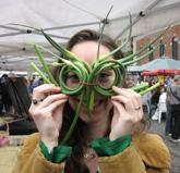 laura with garlic whips around her eyes like sunglasses
