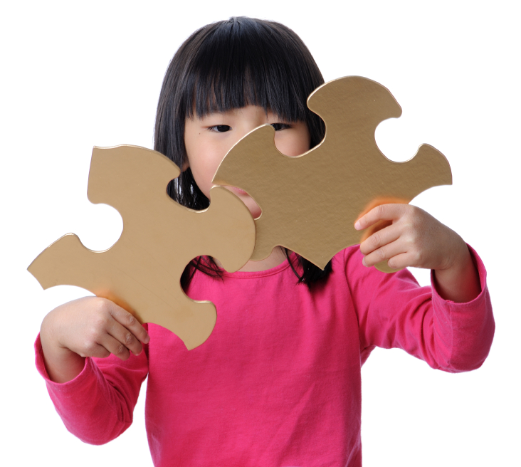 a child putting the pieces of puzzle together