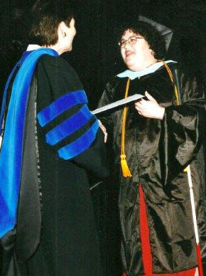 Johnna accepts her diploma at graduation