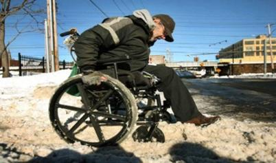 Wheelchair User on Snowy Sidewalk