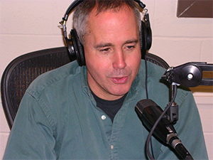 Mark Viette  answers a listeners call during a live broadcast.