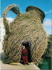Barbara with Wicker Pitcher
