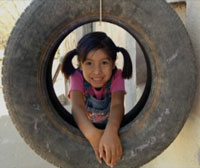 Girl in Tire Swing