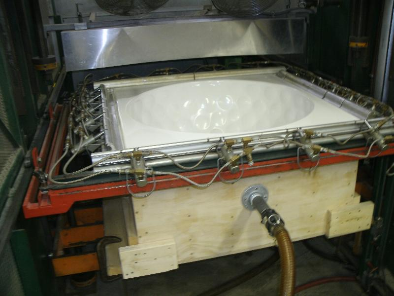 Part in the process of being vacuum-formed