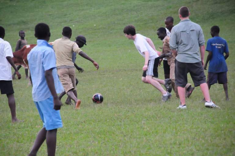 The interns played soccer with the village kids.