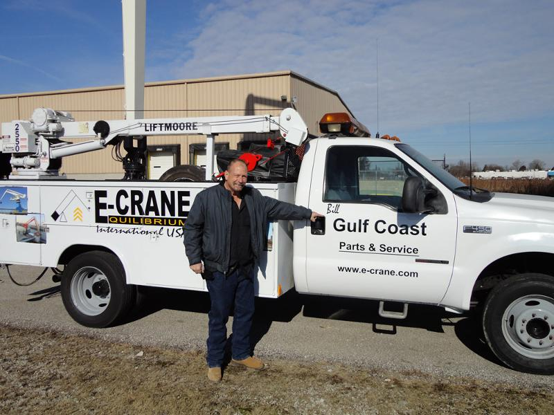 Bill McNair in front of the E-Crane service truck