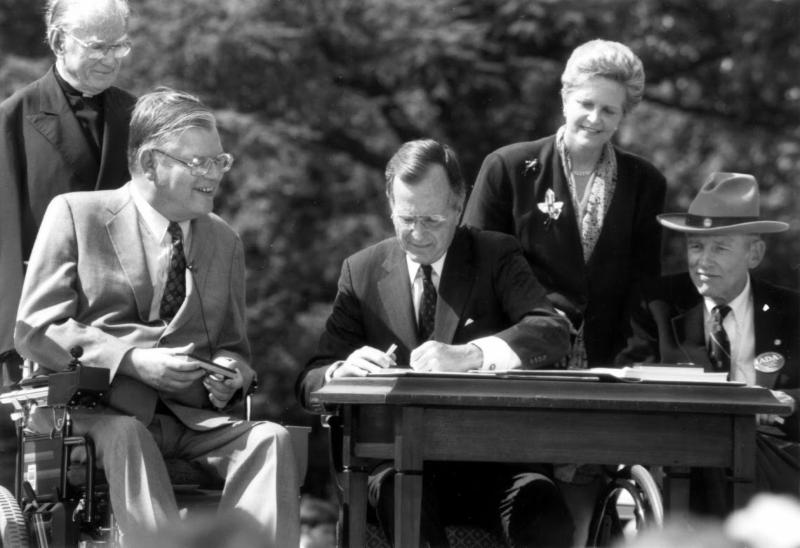 President George H.W. Bush and others at the signing of the Americans with Disabilities Act in 1990