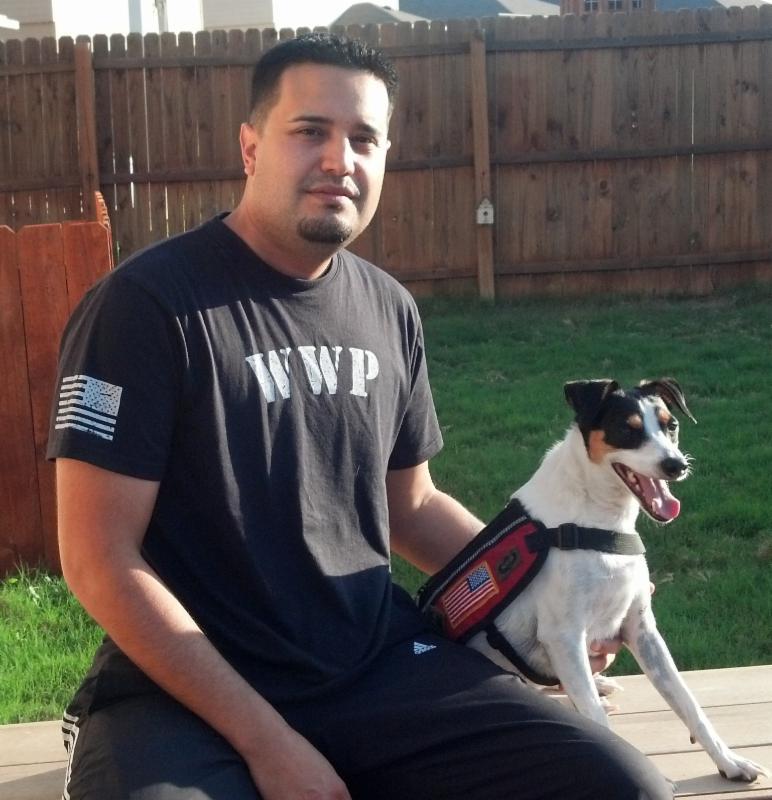 Iraqi war hero Adan Gallegos and his dog, Bootz