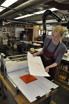 Tarin making a print