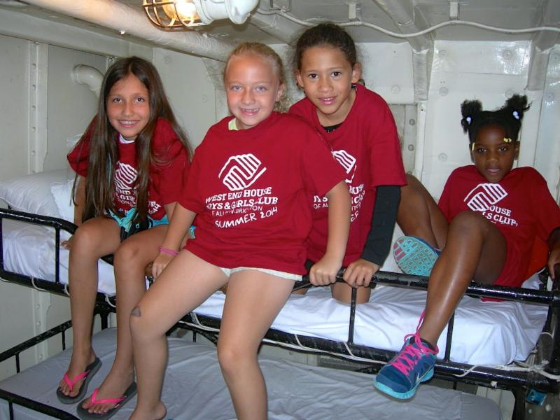 Young visitors trying out one of LV-112's crew bunks