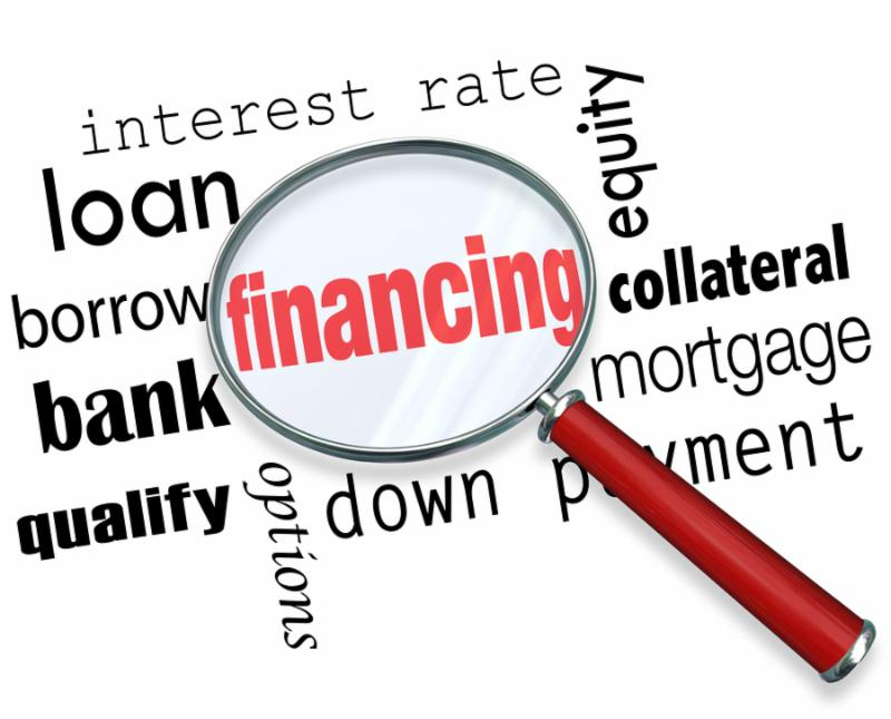 The word Financing under a magnifying glass with terms like interest rate, loan, borrow, bank,...