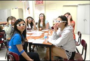 Teens wearing simulator glasses