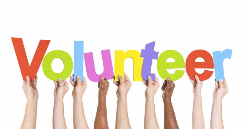 Diverse Hands Holding The Word Volunteer