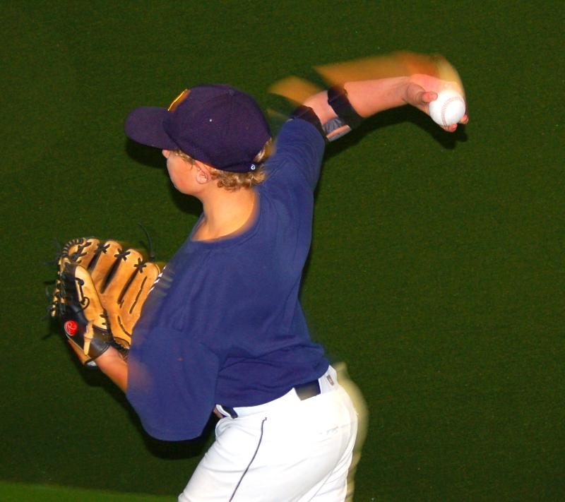 Nick Kafer wearing the ThrowMAX with Maximum Shoulder External rotation throwing a two seam fastball. The Arm blurs with acceleration as shoulders square to target.