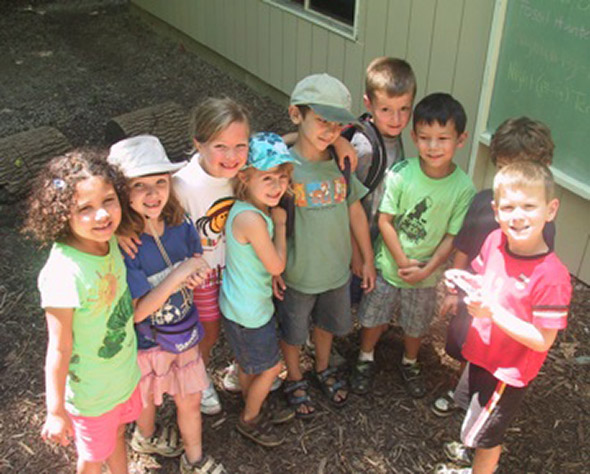 Children posing for a photo at a recent Glen Helen Ecocamp.