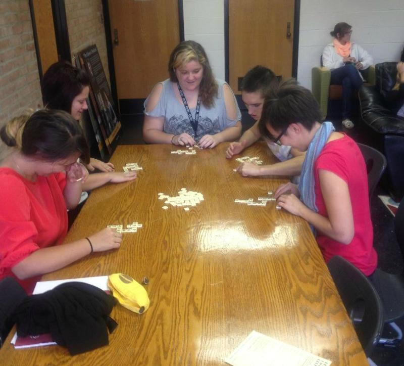 A group of new students play a game of Bananagrams while waiting for registration and advising appointments in the Writing Institute during Orientation on Friday, October 5.
