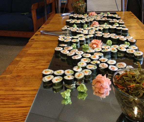 Antioch Kitchens' Isaac DeLamatre and Dan Lawrence whipped up quite a magnificent menu of international fare for the International Dinner on Wednesday, August 8. Pictured is smoked trout and vegetable sushi. Photo by Jennifer Berman.