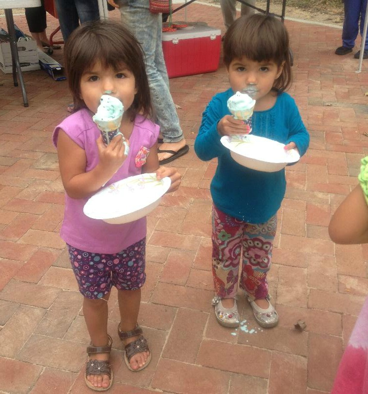 Two of Shane Creepingbear's daughters, Inez and Hazel, enjoying some ice cream at the Miami Valley Alumni Chapter North Hall Ice Cream Social on Monday, September 17.