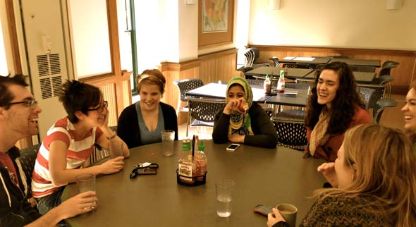 First-year students (L-R) Zachary Sullivan, Kijin Higashibaba, Abigail Lybrook, Saifa Rangrez, Elaine Bell, Emma Persico, and Emmalyn Gilruth enjoy a post-lunch conversation in North Hall before Thanksgiving break.