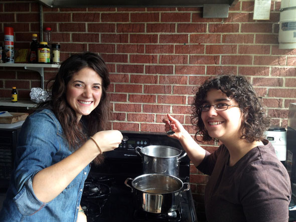 Students Julia Navaro '16 and Sylvia Newman '16 boil sap that they tapped to turn into syrup for their Global Seminar project.