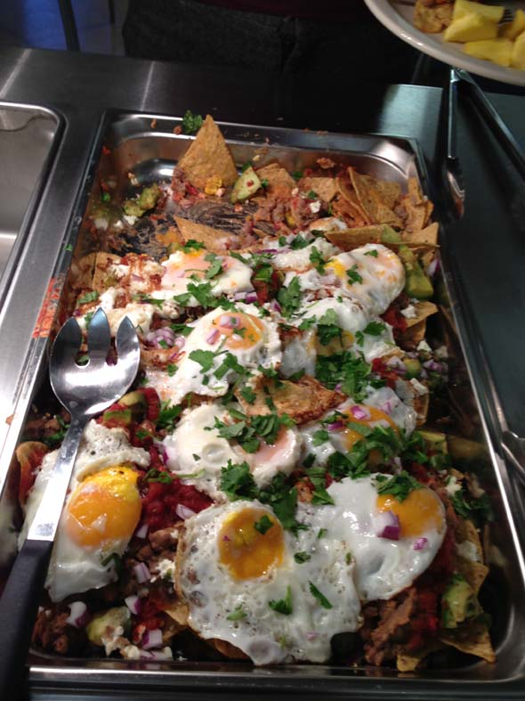 "From student Sara Goldstein '16 on her Spanish breakfast this morning: ""This is the best breakfast I have ever had! The chefs here ROCK!"" This morning, the dining hall served Huevos Rancheros, refried beans, and local corn chips."