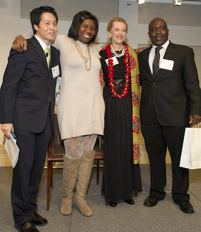 Founder Carole Artigiani is honored by GK alumni Tung Cheng, Mary Oyedijo, and Ranti Ogunleye