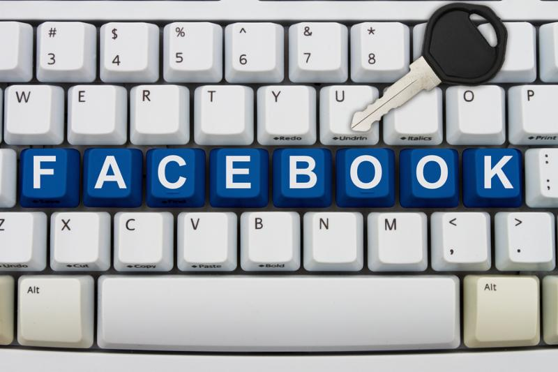 Computer keyboard keys with word Facebook and a key Protecting your Facebook information