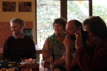 Participants transfixed by Ruby's charm during her cooking class/demo