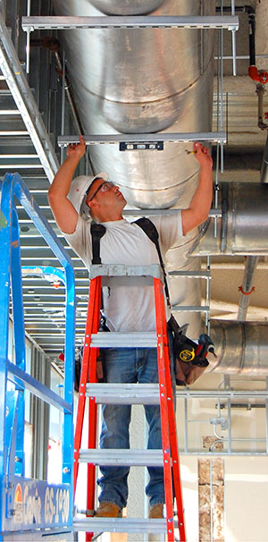 COAC Install Tech Leveling Ductwork