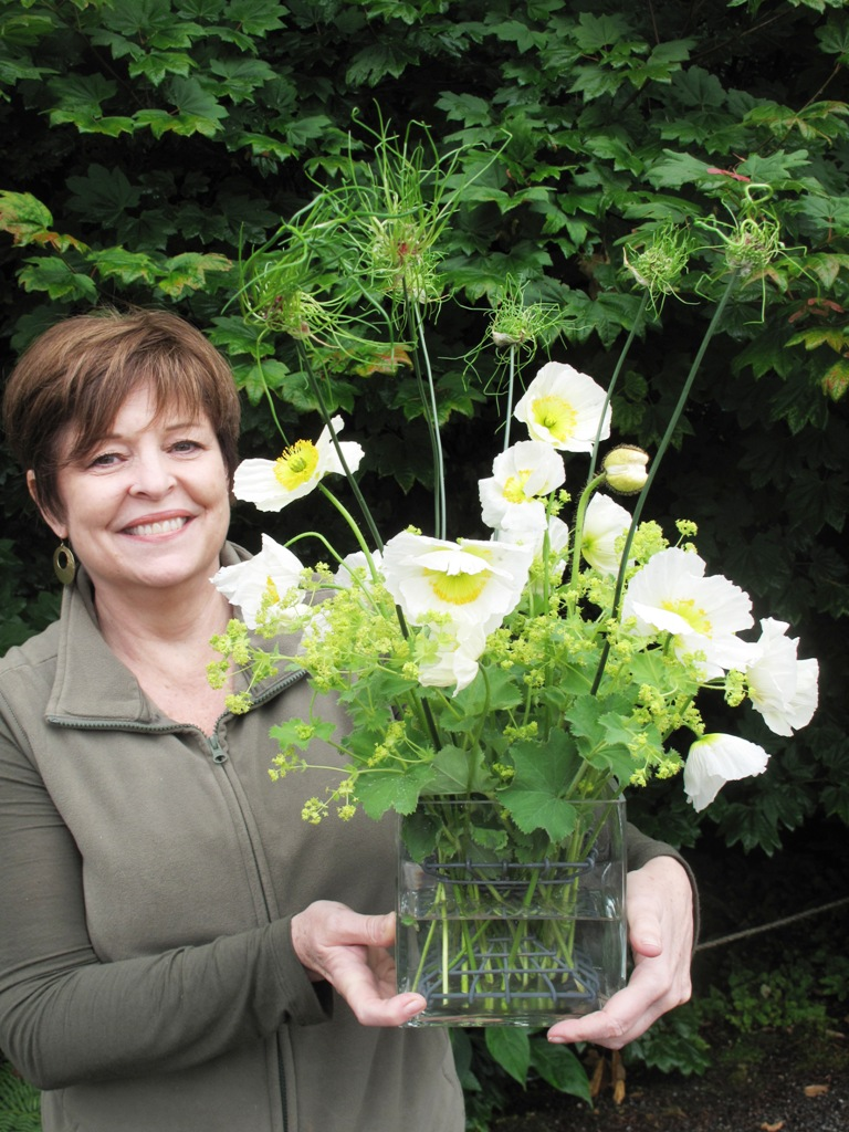 Charmel with lady's mantle, white poppies and 'Hair' ornamental allium bouquet