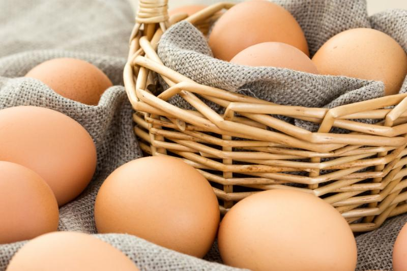 Close-up of brown eggs in a basket