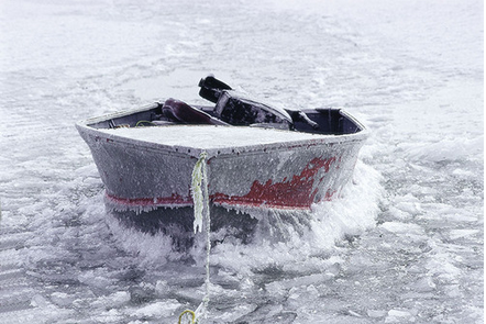 A small motor boat is frozen to the lake after the sudden Fall freeze on Great Slave Lake.