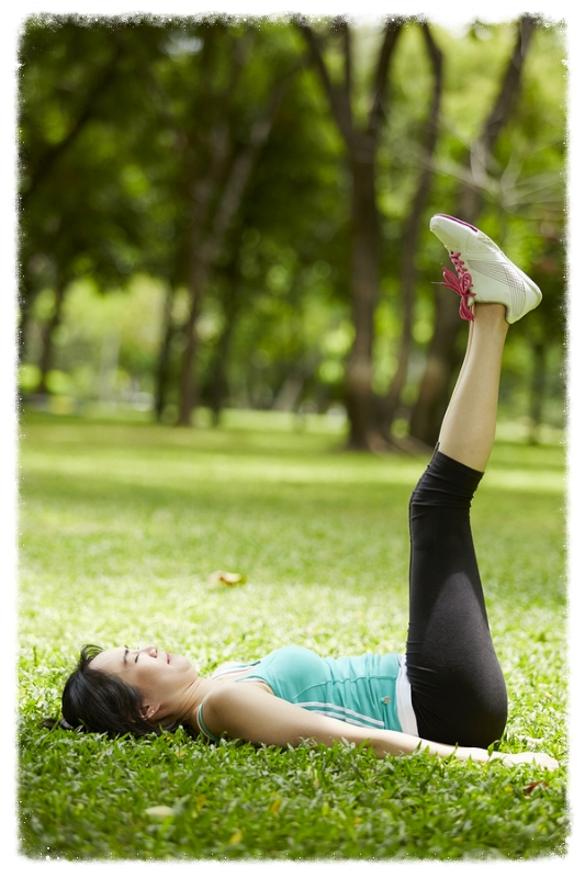 Stretching woman in outdoor exercise smiling happy doing yoga stretches after running-Beautiful happy smiling sport fitness     Note  Visible grain at 100 , best at smaller sizes