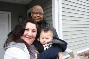 Gross family in front of their Palmer Pointe Townhome.