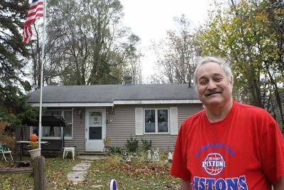 Jack Dobrecki in front of his home.
