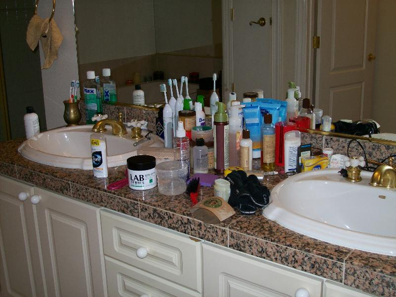 un clutter the bathroom counter tops simply organized