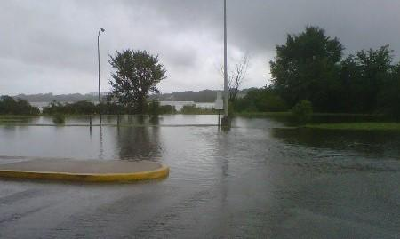 Flooding in a hospital parking lot after a storm