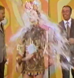 Judy Carne being doused with water.
