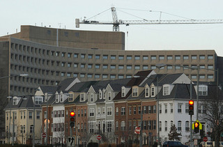HUD headquarters looms behind a row of houses. Photo by flickr user dbking