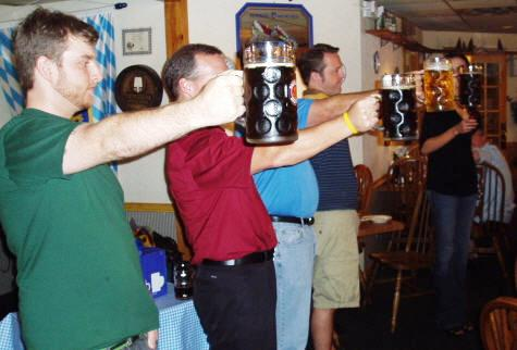 Men holding 1 liter Stein filled with Hofbrau beer