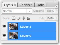 Adobe Phtoshop: Select both layers by clicking on one and then Shift+clicking the other