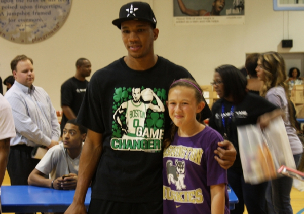 Avery Bradley with a young fan from his 1st Annual Avery Bradley Back  2 School Backpack Giveaway (9-04-2012)
