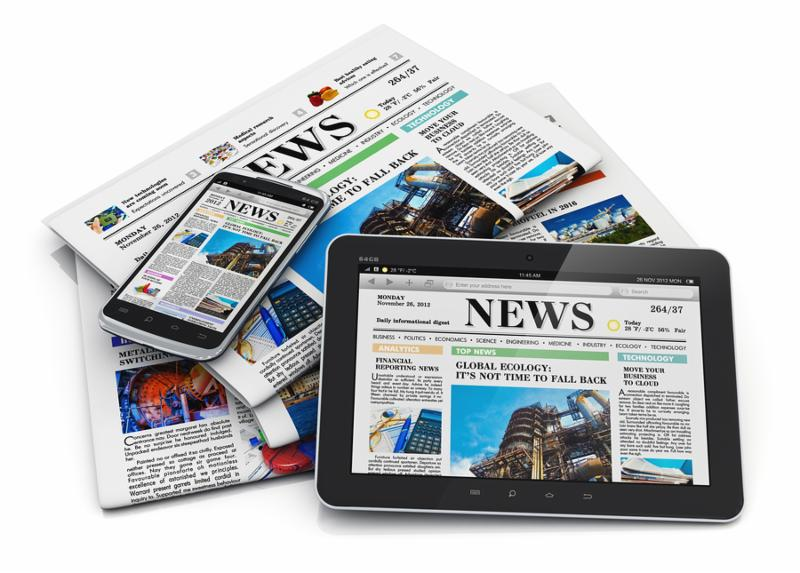 Electronic internet web and paper media concept  tablet PC computer modern black glossy touchscreen smartphone and heap of business office newspapers with financial news isolated on white background