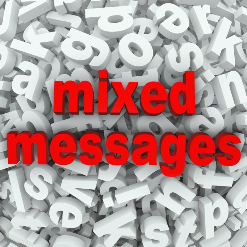 The words Mixed Messages on a background of random letters and words to illustrate poor...