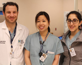 From left, Dr. Peter Stotland with surgical resident Dr. Natalie Wong-Chong and clinical clerk Gilly Akhatar-Denesh