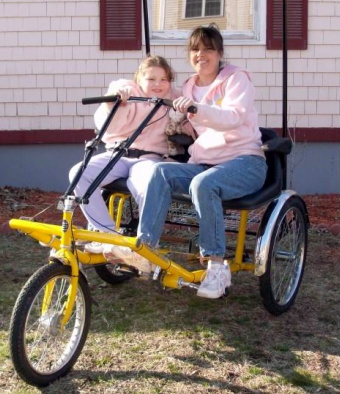 The Woodburys on their new tricycle