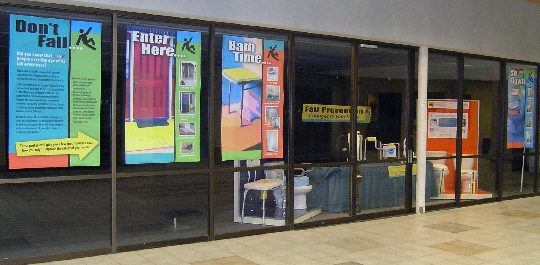 fall prevention mall display: posters and devices behind windows