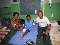 Photo of Richard Lumarque and two Haitian women, one an amputee.